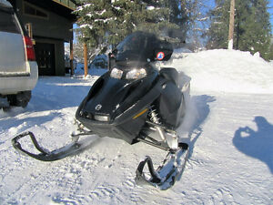 Two 2007 summit skidoos