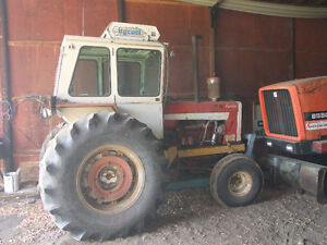 IH 1206 Tractor and Ezee-On 120 High Lift Loader