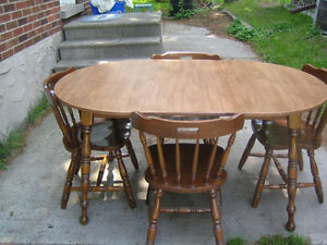 Free wood dining table with 4 wood chairs.