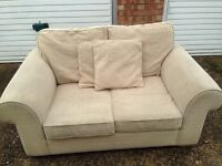 """Cream /Beige two seater sofa """"free delivery """" £50"""