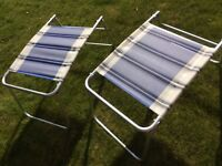 2 FOLDING LEG RESTS FOR CARAVAN MOTOR HOME FOLDING CHAIRS. USED ONCE ONLY. LIGHTWEIGHT ALLOY.