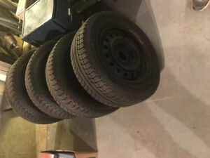 Four Michelin X-Ice 2 Winter Tires with Rims