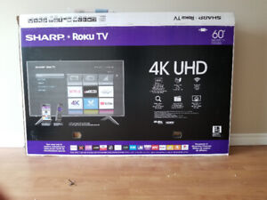Selling 60 inch sharp 4k roku tv never used 560!!!!