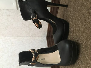 Various black and gold pumps