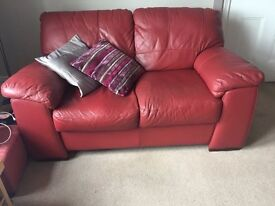 Red leather settees in very good condition