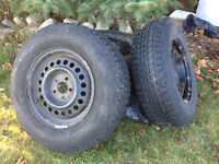 Firestone Winterforce snow tires with rims