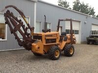 Case DH5 trencher and vibratory plow