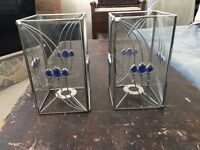 A pair of candle holder/lamp shade