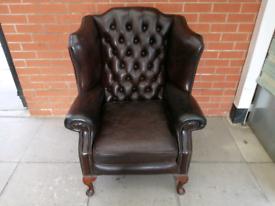 A Dark Brown Georgian Leather Chesterfield Queen Ann Wing chair