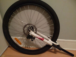 """Front shock with disk brake, rim, 26"""", tire."""