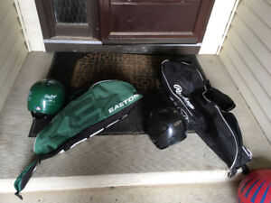Children's bat and ball bags (two) and helmets (two) like new