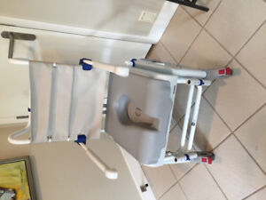 Wheel chair (with built-in commode). In good condition $75.