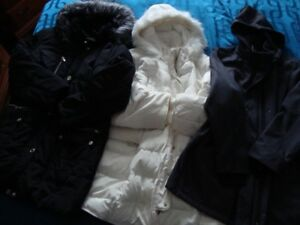 For Woman: Two winter coats  and one spring coat.  Size 3X.