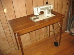 Almost unused Kenmore sewing machine and table