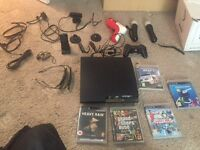 Ps3 with games complete with extras