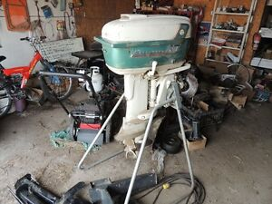 Gale buccaneer 25 hp outboard motor and stand