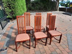 Six modern wooden dining chairs, used