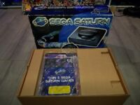 Sega Saturn console boxed with manuals, controller leads and 1 game