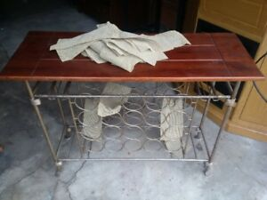Vintage metal winerack with wooded service counter. $40