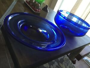 Blue glass salad bowl and platter