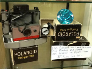 1965 polaroid camera,flasm/timer,boxes/;books
