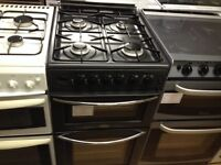 Double oven black gas cooker