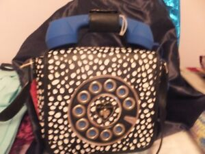 A BETSY JOHNSON LADIES PURSE WITH TELEPHONE HANDLE