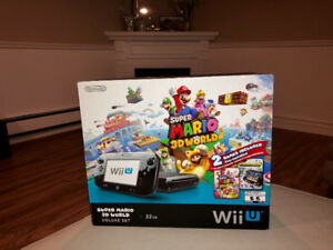 Wii U console with 10 games and extra controllers.