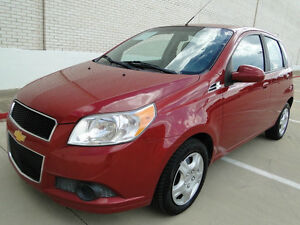 $7,000. (8328KM LOW MILEAGE RED 2011 Chevrolet Aveo LT Hatchback