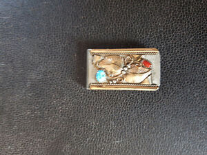 Ornate money clip with coral inlays
