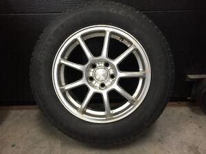 Mags avec pneus d'hiver