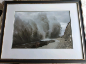 Framed photograph of waves during a storm