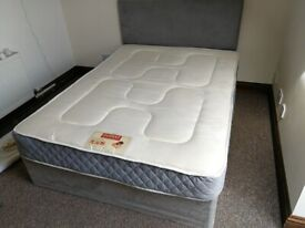 Double Divan Bed base with mattress and headboard.