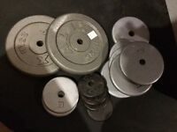 150 Lbs of steel weight plates with 1 inch hole