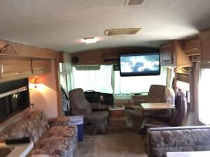 36' class A with super slide & tag axle may trade