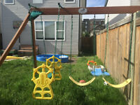 swing set that attached to playhouse or fence