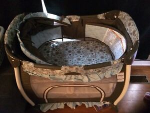 Travel size Playpen with Bassinet, storage and music