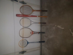 various rackets and baseball bat