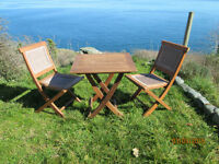 Solid teak table and chairs