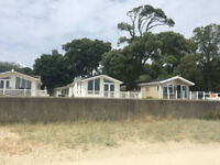 Luxery Holiday Lodge with stunning uninterupted sea views at Sandhills Holiday Park, Mudeford