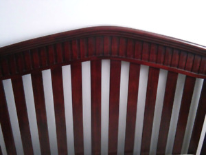 Beautiful cherry wood crib with extras