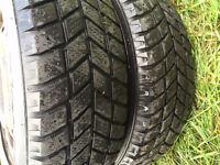 2 pneus d'hiver 185-65-14 hankook sur rims 4x100 80$