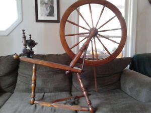 Antique spinning wheel with cast iron treddle