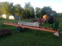 "Home made portable saw mill 16 foot by 32 "" high"