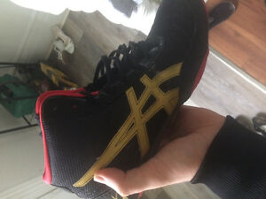 Red and black asics boxing/running shoes