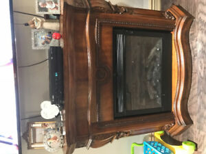 Wood cabinet with electric fireplace