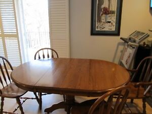 Solid Oak  Table and four Chair's