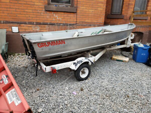 12 ft aluminum fishing boat with trailer and 4.5 hp motor.
