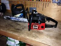Used Jonsered Chain Saw with 2 Gas Can and Chain Oil