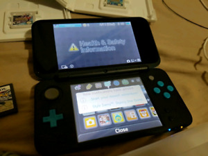Brand new Nintendo 2Ds with pokemon games and SD card holder